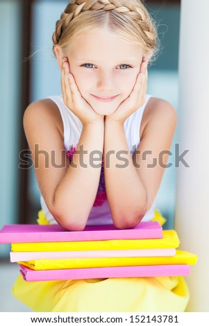 Education - funny girl with a stack of books - stock photo