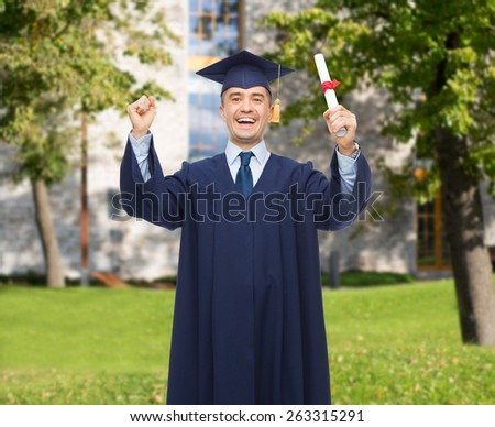 education, graduation and people concept - smiling adult student in mortarboard with diploma rising hands up and laughing over campus background - stock photo