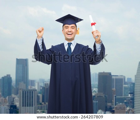 education, graduation and people concept - smiling adult student in mortarboard with diploma rising hands up and laughing over city background - stock photo