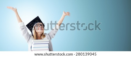 education, happiness, graduation and people concept - picture of happy student in mortar board cap with stack of books over blue background - stock photo