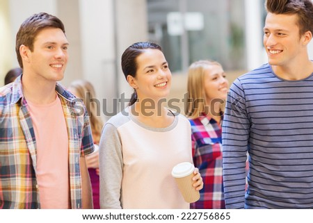 education, high school, friendship, drinks and people concept - group of smiling students with paper coffee cups - stock photo