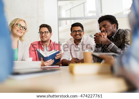 Group Of People Talking At Table