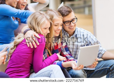 education, high school, technology and people concept - group of smiling students with tablet pc computers taking photo or video indoors - stock photo