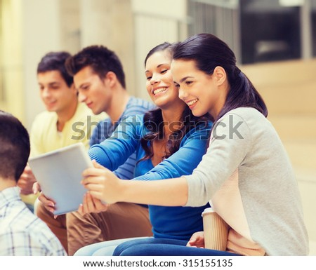 education, high school, technology and people concept - group of smiling students with tablet pc computers making photo or video indoors - stock photo