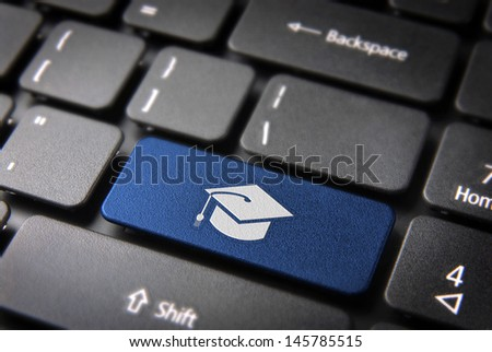 Education key with graduation hat icon on laptop keyboard. Included clipping path, so you can easily edit it. - stock photo