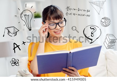 education, knowledge, vision, literature and people concept - smiling young asian woman or student girl in glasses reading book at home over school doodles