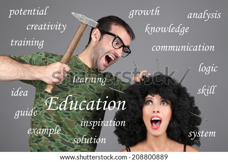 Education, Learning, Tutor Concept. Putting information in head. A man is hammering nails into a girl's head. - stock photo