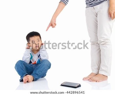 Education of the child. mother scolds her child boy playing game on smartphone. family relationships - stock photo