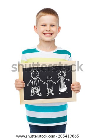 education, school and advertisement concept - smiling little boy holding black chalkboard with family drawing - stock photo