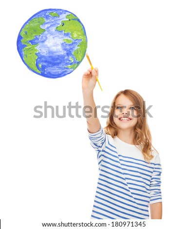 education, school and imaginary screen concept - cute little girl drawing with brush planet earth - stock photo
