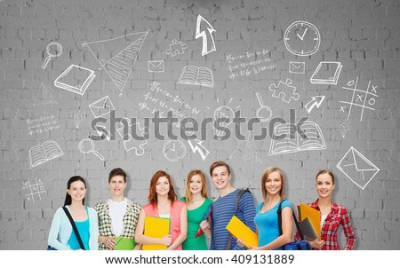education, school and people concept - group of smiling teenage students with folders and school bags over background - stock photo