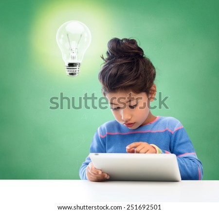 education, school, technology and children concept - little student girl with tablet pc over green chalk board background - stock photo