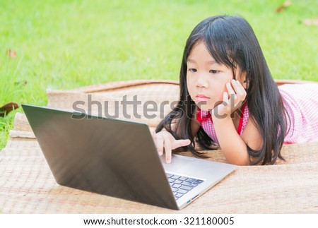 education, school, technology and internet concept - Cute girl with laptop pc at home