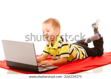 Education, school, technology and internet concept - little student boy with laptop pc computer - stock photo