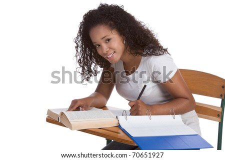 education series - ethnic black woman high school student sitting by school desk doing homework - stock photo