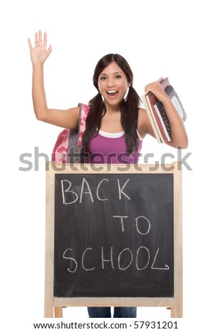 education series - Friendly ethnic Hispanic woman high school student by chalkboard - stock photo