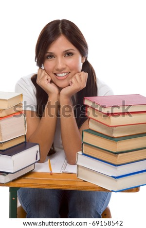 education series - Friendly ethnic Latina female high school student with books by desk - stock photo