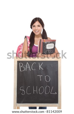 education series template - Friendly ethnic Latina woman high school student by chalkboard - stock photo
