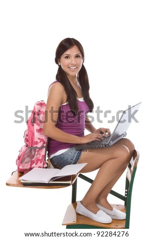 education series template - Friendly young woman high school student typing on portable computer - stock photo