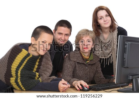 Education, smiling Caucasian students and teacher with computer