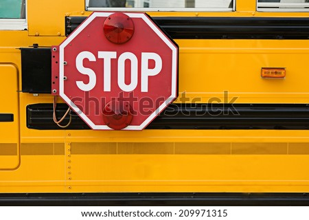 Education: Stop Sign On Side Of School Bus - stock photo