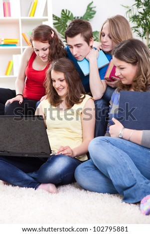 Education - Students working together in living room - stock photo