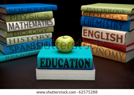 education study books with text learning building knowledge at school with healthy apple - stock photo