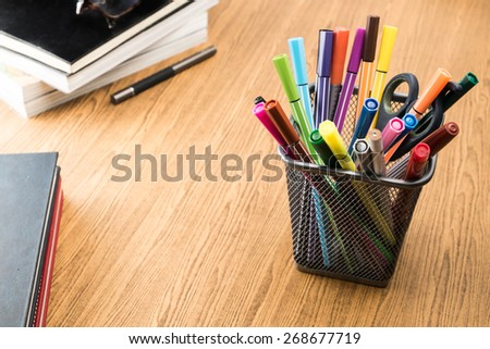 education stuff on wooden table.pen ,colour pen ,book - stock photo