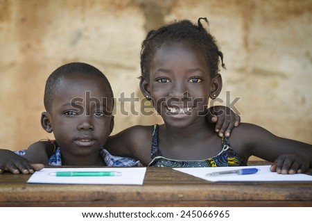 Education Symbol: Couple of African Children Smiling at School - stock photo