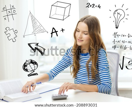 education, technology and home concept - smiling student girl with book, notebook and calculator - stock photo