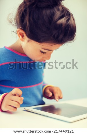 education, technology and internet concept - little girl with tablet pc - stock photo