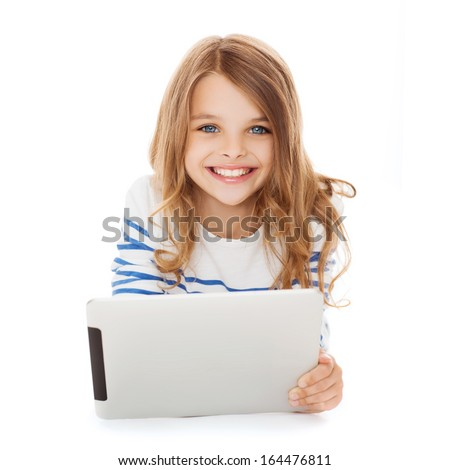 education, technology and internet concept - smiling little student girl with tablet pc computer