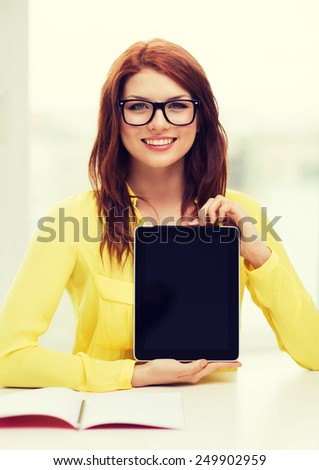 education, technology and internet concept - smiling student girl in eyeglasses with tablet pc at school - stock photo