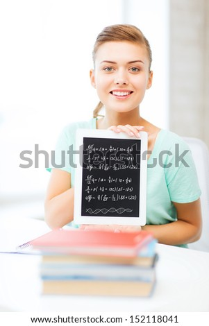 education, technology and internet concept - smiling student girl with tablet pc - stock photo