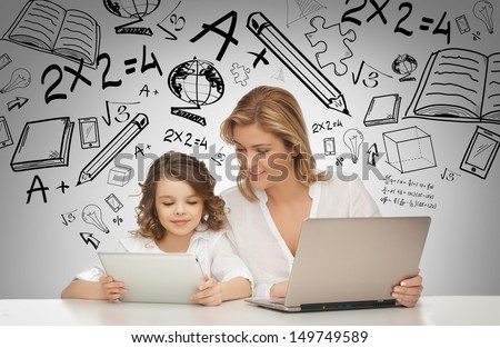 education, technology, internet and parenting concept - girl and mother with tablet and laptop - stock photo
