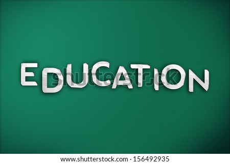 Education Text on Green Chalk Board - stock photo