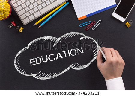 EDUCATION written on Chalkboard - stock photo
