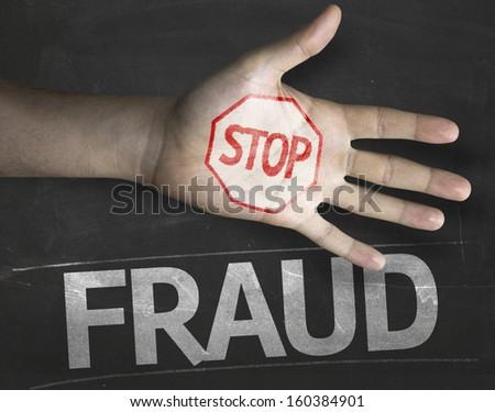 Educational and Creative composition with the message Stop Fraud on the blackboard - stock photo
