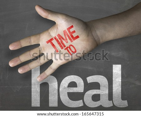 Educational and Creative composition with the message Time to Heal on the blackboard - stock photo