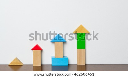 Educational block toy rising up. Colorful toy block for growing in education concepts.