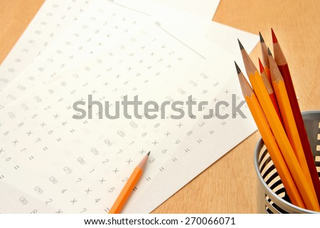 Educational concept, pencils and test - stock photo