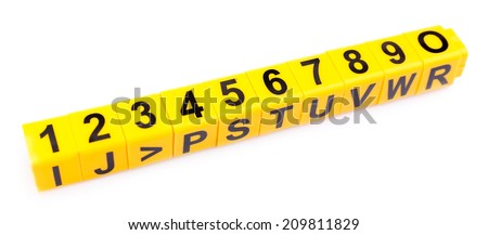 Educational cubes with different numbers isolated on white - stock photo