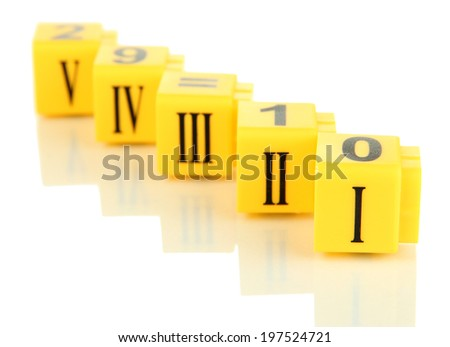 Educational cubes with Roman numerals isolated on white - stock photo