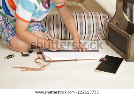 Educational indoor play activity: drawing and writing - stock photo