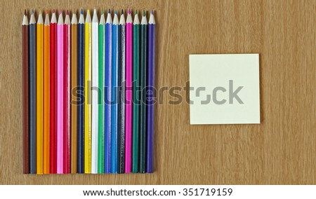 Educational or Art background, pencil crayons, with post it and text space. Panorama / header / banner. - stock photo