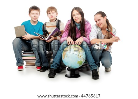 Educational theme: group of emotional teenagers sitting  together on books. - stock photo