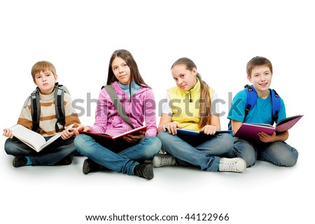 Educational theme: group of teenagers sitting together and reading books. - stock photo