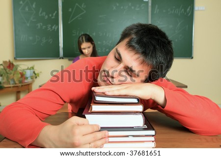 Educational theme: male student in a classroom. - stock photo