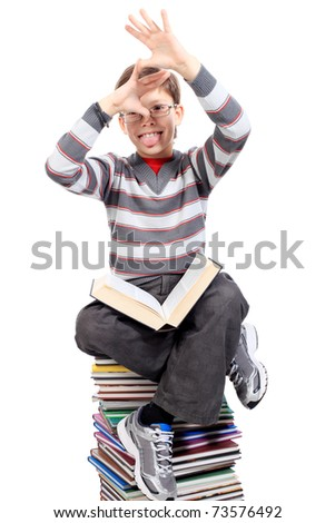 Educational theme: portrait of a shouting schoolboy with books. Isolated over white background. - stock photo