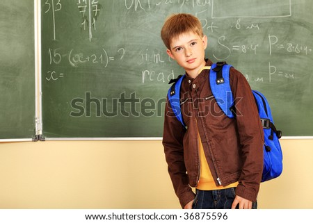 Educational theme: schoolboy in a classroom. - stock photo